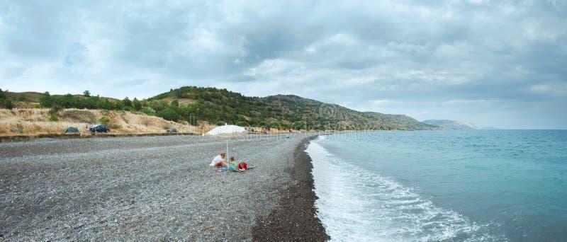 Family on summer beach in Crimea, Ukraine. royalty free stock images