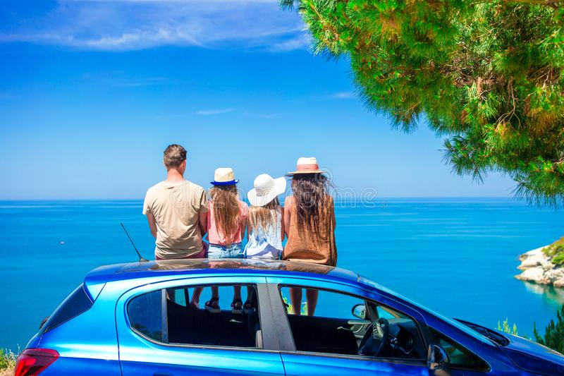 Summer car trip and young family on vacation stock images