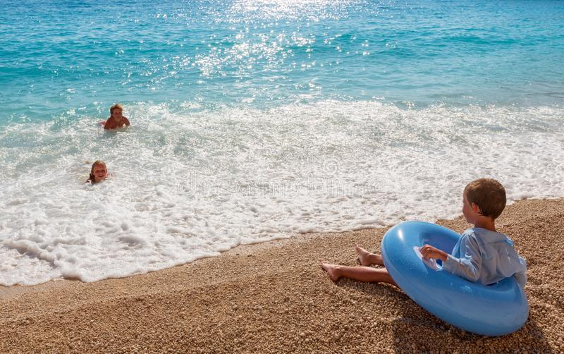 Family on summer Ionian sea stock images