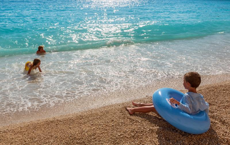 Family on summer Ionian sea stock photography