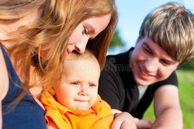 Download Family In Summer - Mother, Father And Child Royalty Free Stock Images - Image: 23576559