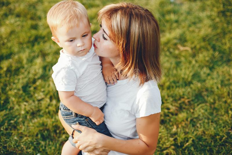 Mother with son playing in a summer park stock image