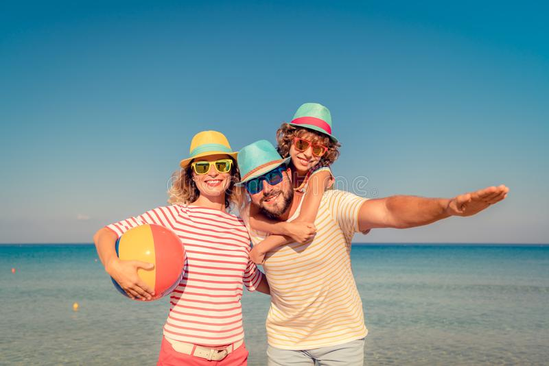 Family Summer Vacation Beach Sea. Happy family on summer vacation. People having fun on the beach. Active healthy lifestyle royalty free stock photography