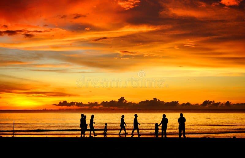 Family sunset. A family walking during sunset time.Tanjung Aru Beach kota kinabalu sabah malaysia stock photography