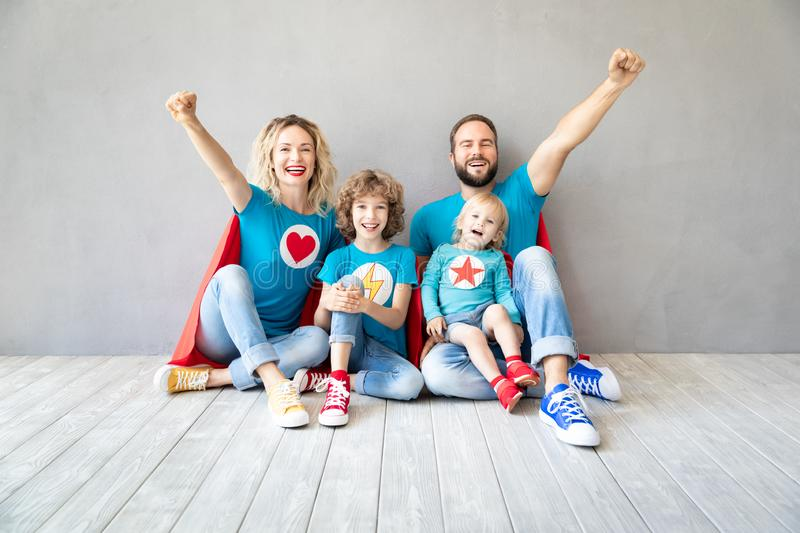 Family of superheroes playing at home stock photo