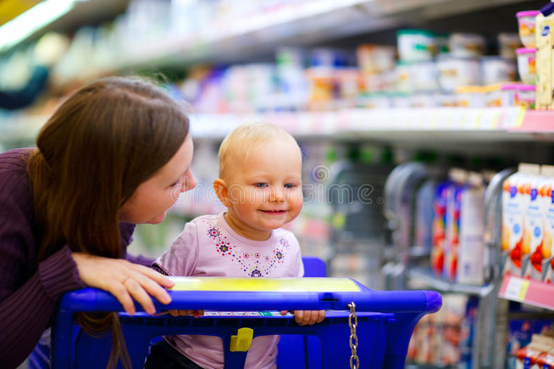 Family in supermarket royalty free stock images
