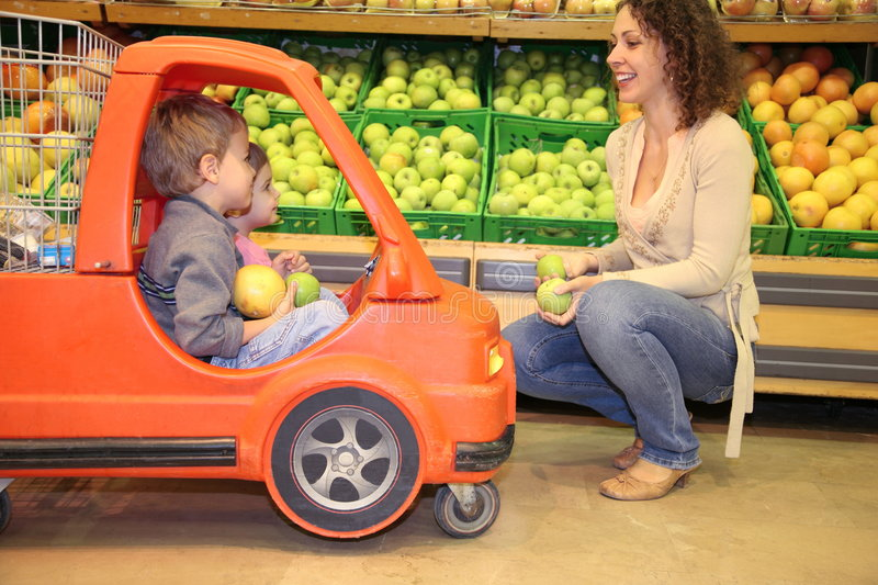 Family in the supermarket stock photography