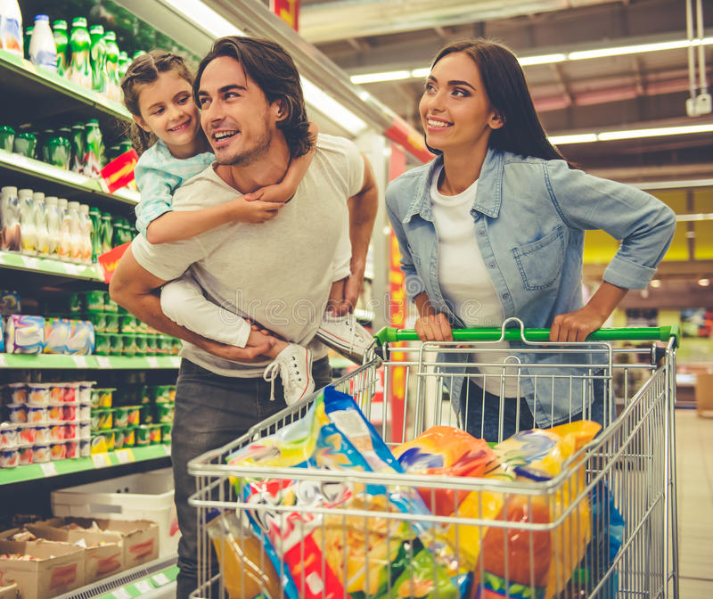 Family in the supermarket royalty free stock images