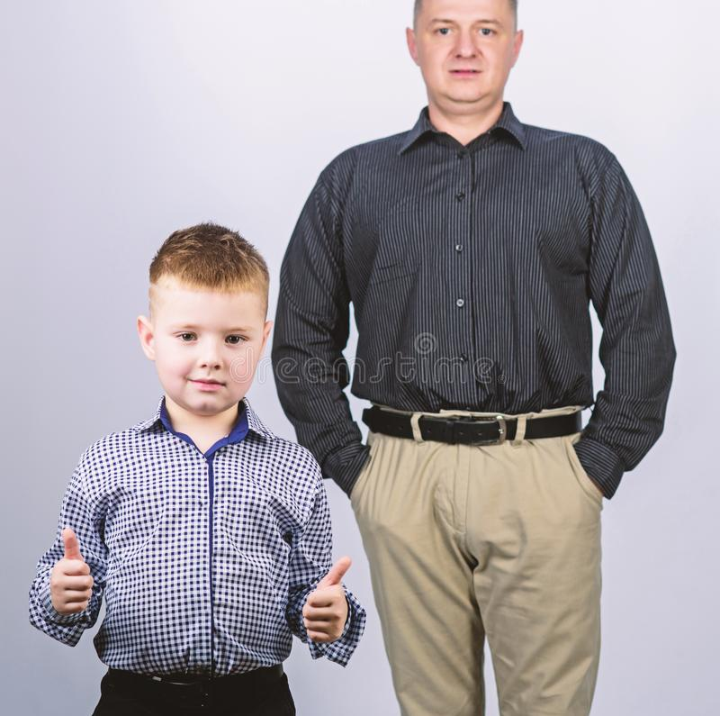 Family support. Family bonds. Trustful relations father and son. Enjoying fatherhood. Father and cheerful little son. Best friends. Dad and adorable child royalty free stock image