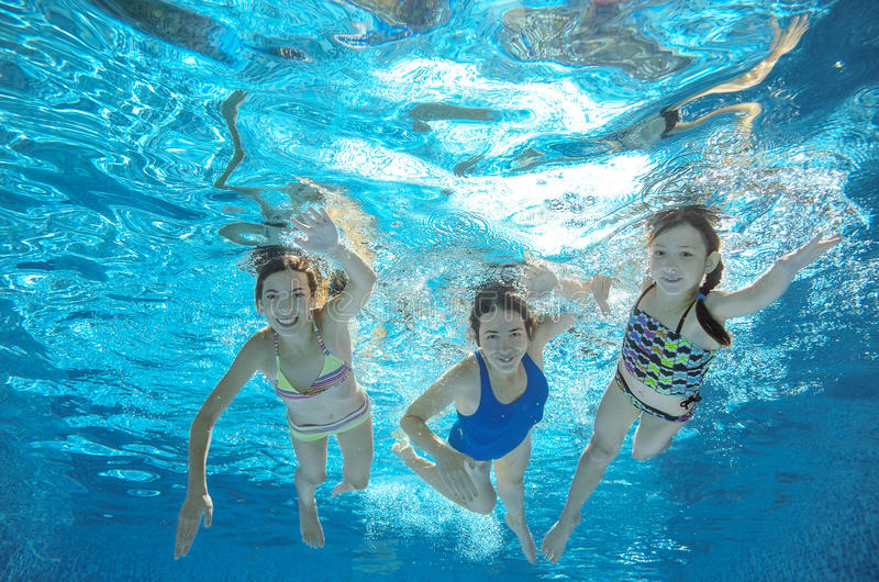 Family swim in pool or sea underwater, mother and children have fun in water. Family swim in pool or sea underwater, happy active mother and children have fun in stock image