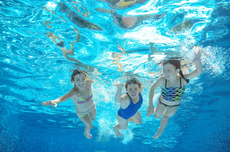Family swim in pool or sea underwater, mother and children have fun in water. Family swim in pool or sea underwater, happy active mother and children have fun in royalty free stock photos