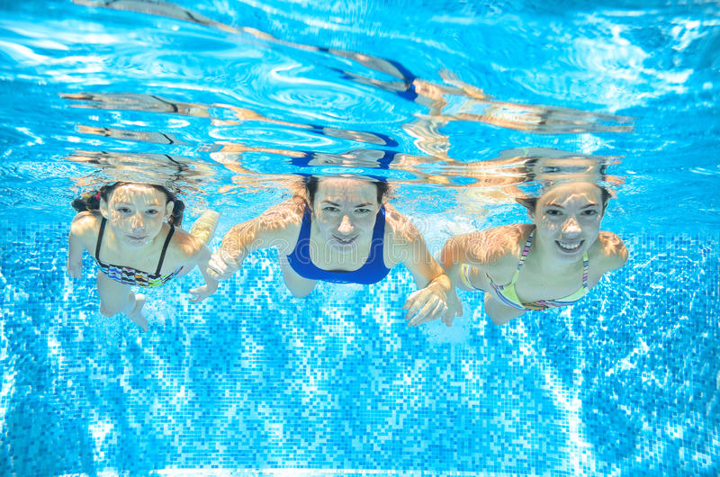 Family swim in pool underwater, mother and children have fun in water,. Family swim in pool underwater, happy active mother and children have fun in water, kids royalty free stock photos