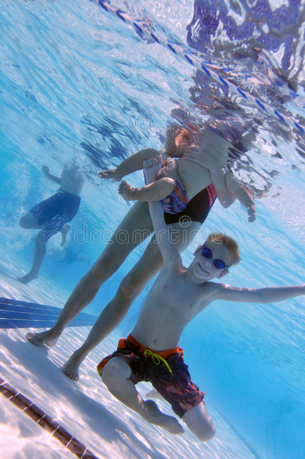 Family At Swimming Pool Stock Photography