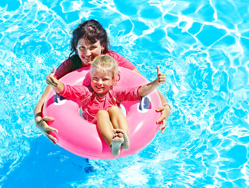 Family In Swimming Pool. Stock Photography