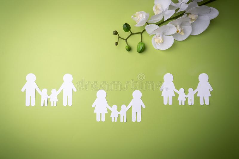 Family symbol cut out of white paper. Protecting the rights of people and sexual minorities. Love for the children of the world on stock photos