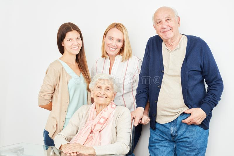 Family takes care of senior couple royalty free stock photo
