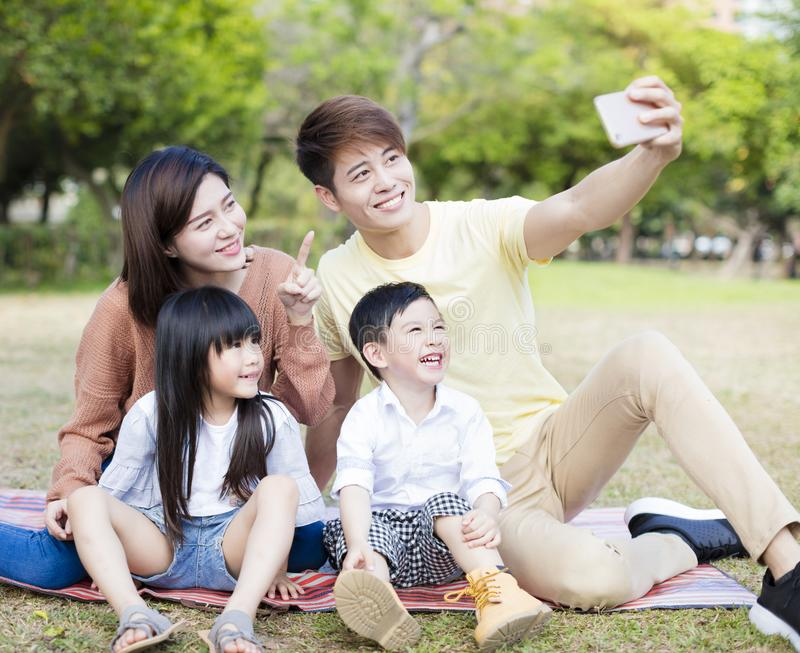 Family taking selfie in the park stock images