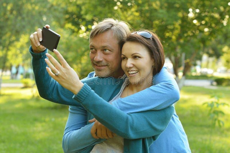 Family taking selfie in park royalty free stock image