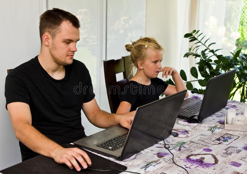 Brother and sister together with laptop computers royalty free stock photo