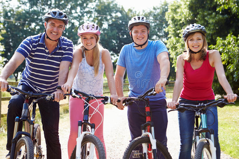Family With Teenage Children On Cycle Ride In Countryside. Smiling At Camera royalty free stock image