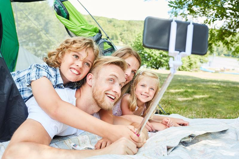 Family in tent makes selfie with smartphone stock photos