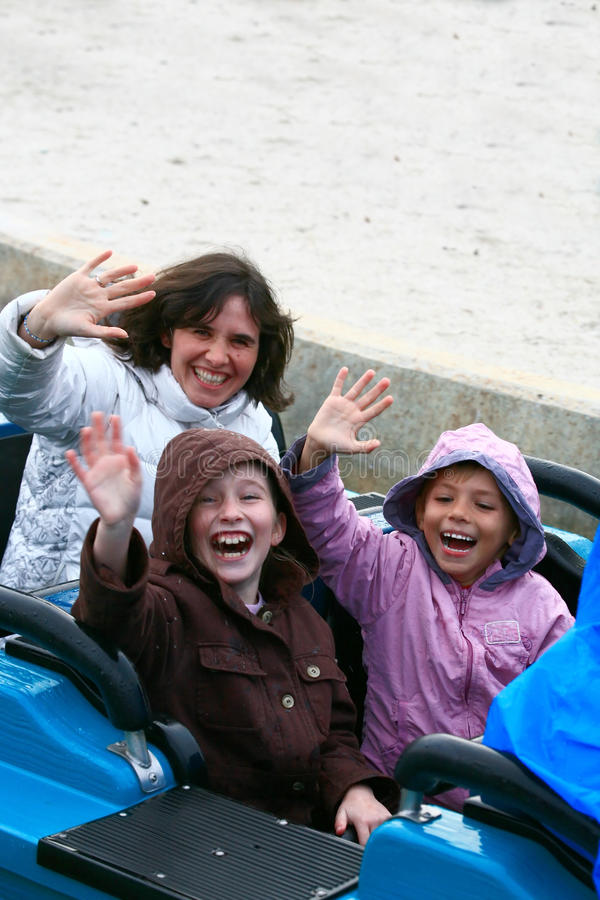 Family at theme park. On a wet ride royalty free stock photo