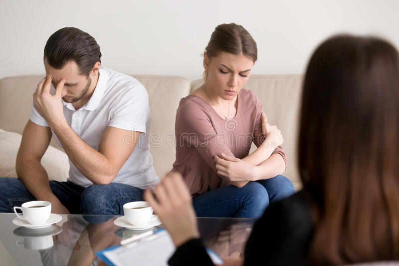 Family therapy, couple after argument not talking to each other stock photos