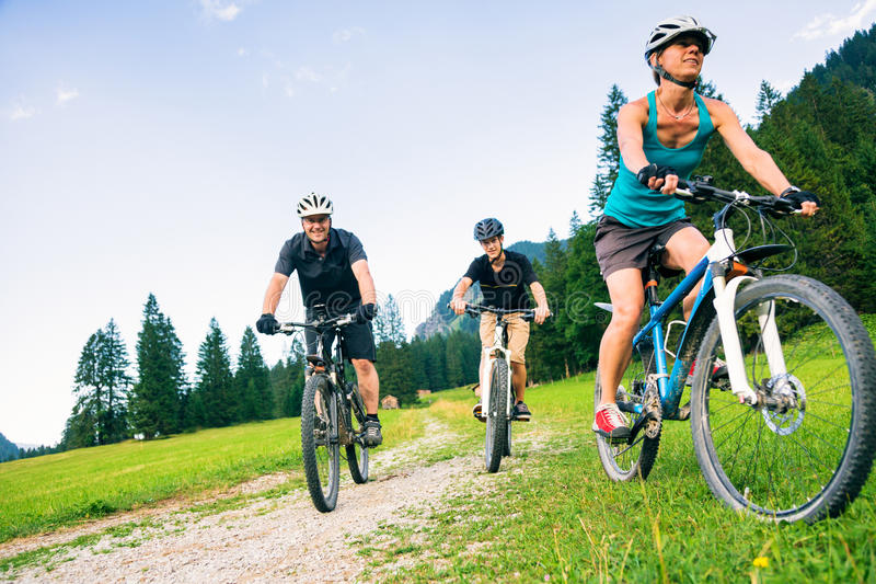 Family Of Three Cycling royalty free stock photography