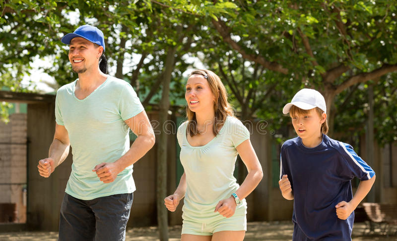 Family of three doing running outdoor stock images