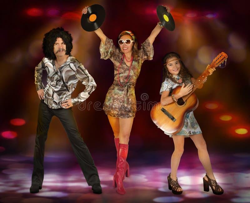 Disco family perform on stage royalty free stock photos