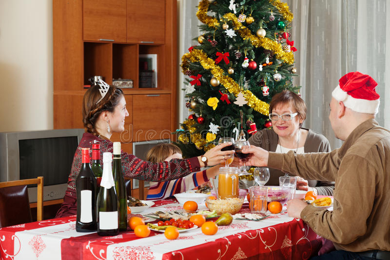 Family of three generations celebrating Christmas. Over holiday table royalty free stock images