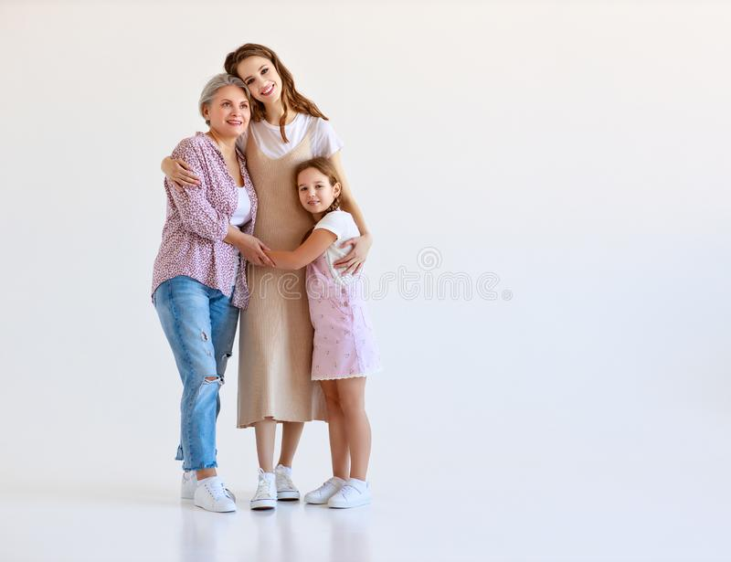 Family three generations  grandmother, mother and child on white background. Happy family three generations   grandmother, mother and child on white background royalty free stock photos