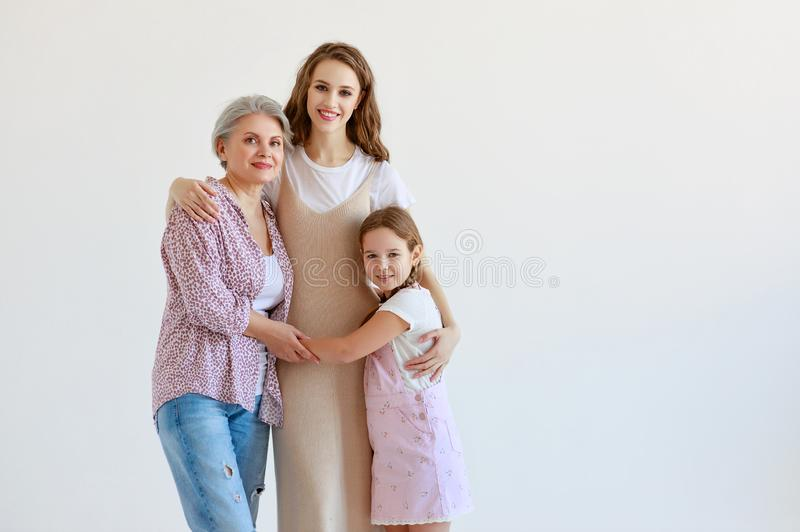 Family three generations  grandmother, mother and child on white background. Happy family three generations   grandmother, mother and child on white background royalty free stock photography