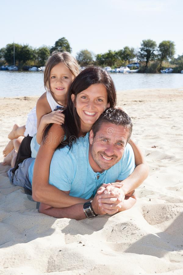 A Family of three having fun on european beach stock images