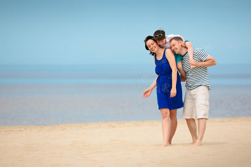 Download Family Of Three Having Fun On Tropical Beach Stock Image - Image: 28994045