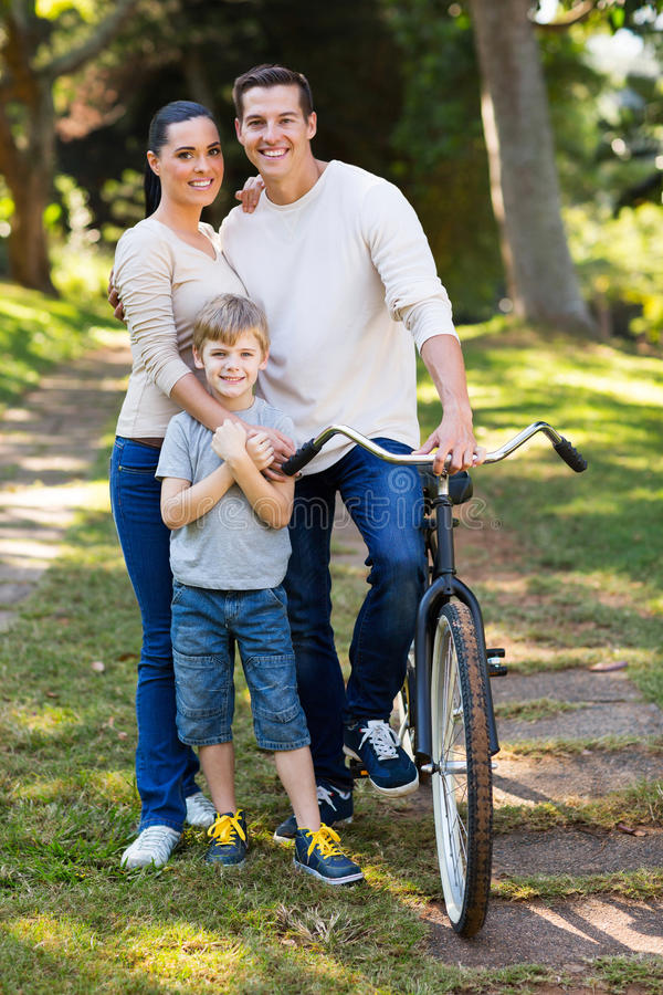 Family of three outdoors. Cute young family of three portrait outdoors stock image