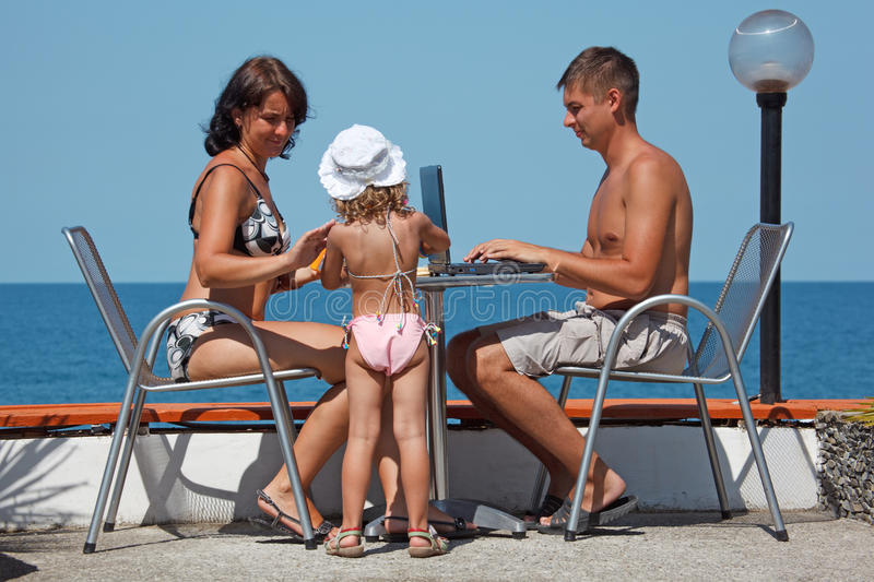 Family of three people resting on sea. stock image