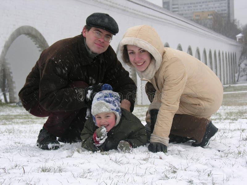 Family of three. snow. royalty free stock image