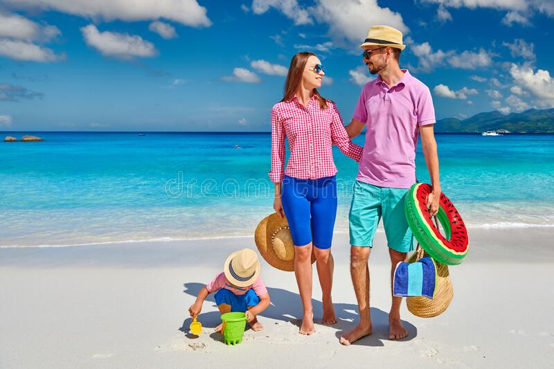 Family with three year old boy on beach. Seychelles, Mahe royalty free stock images