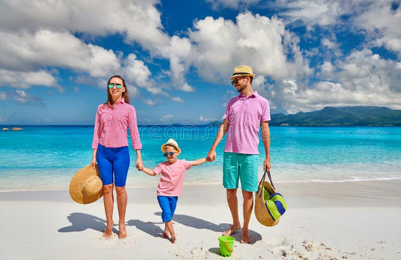 Family with three year old boy on beach. Seychelles, Mahe stock image