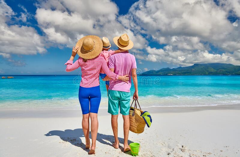 Family with three year old boy on beach. Seychelles, Mahe royalty free stock image