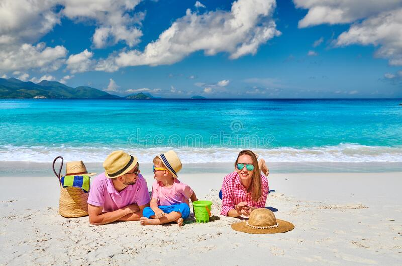 Family with three year old boy on beach. Seychelles, Mahe stock images