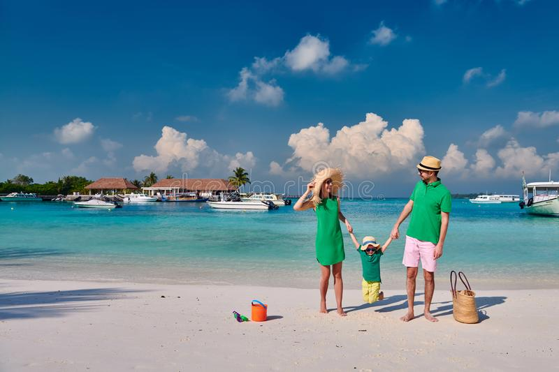 Family with three year old boy on beach stock images