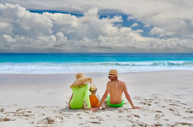 Family with three year old boy on beach royalty free stock image