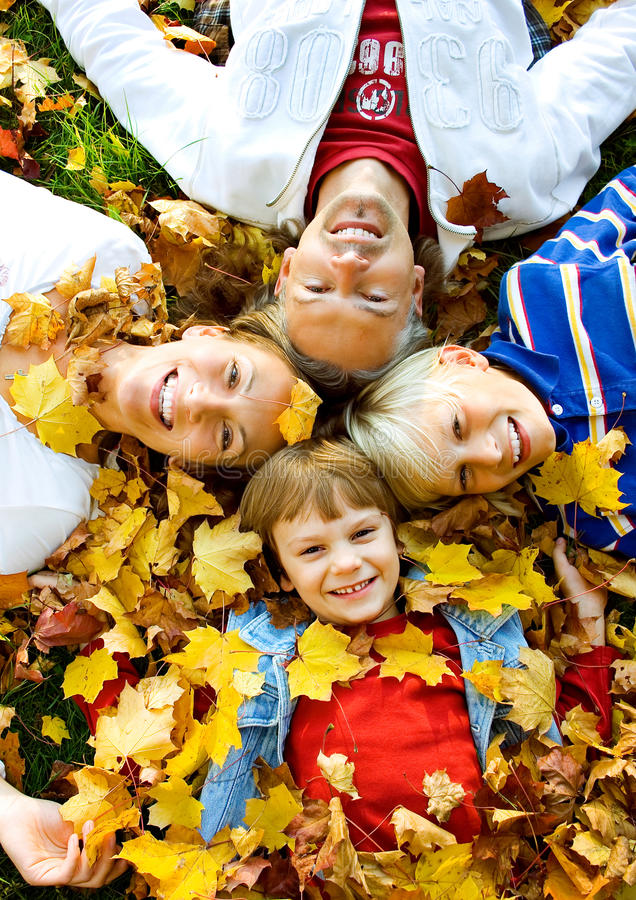 Family time 1. Cute family in autumn with leaves royalty free stock images