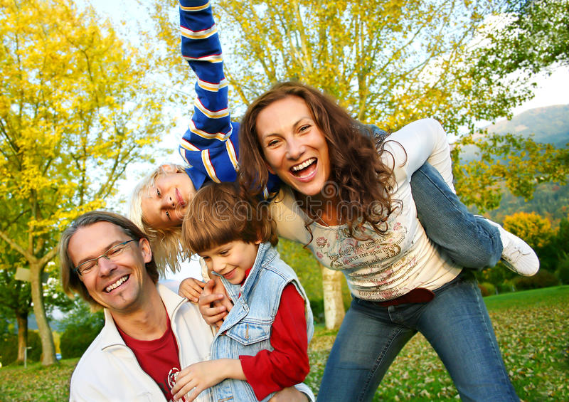 Family time 10. Happy family in a park stock image