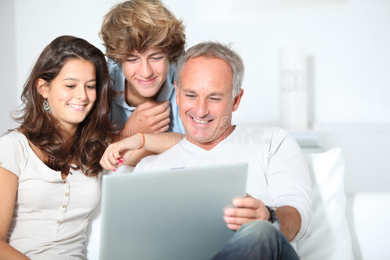 Family time. Family at home with laptop computer