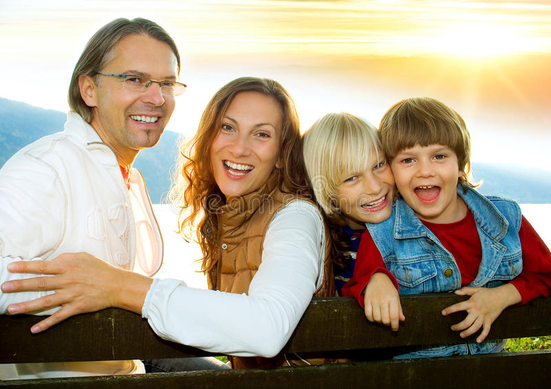 Family time 4. Happy family in the sunset royalty free stock photo