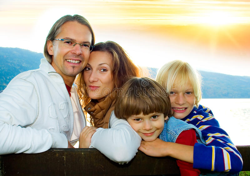 Family time 5. Happy family in the sunset stock photos