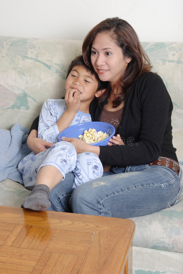 Family time. Mom and son watching a movie together